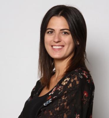 woman smiling at camera wearing black shirt headshot