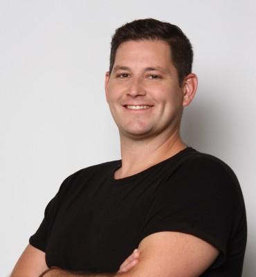 Aaron Peterson, Man wearing black shirt smiling, headshot