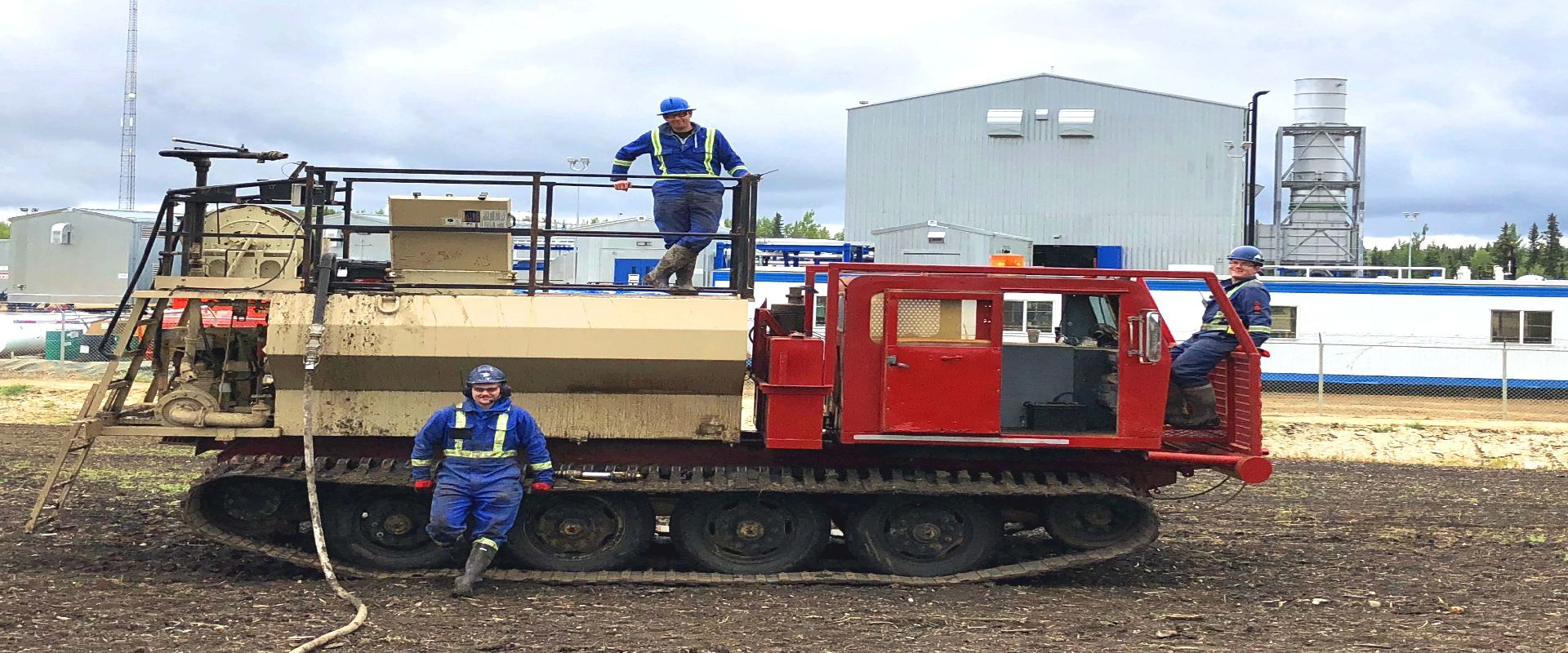 3 workers on hydroseeding equipments smiling